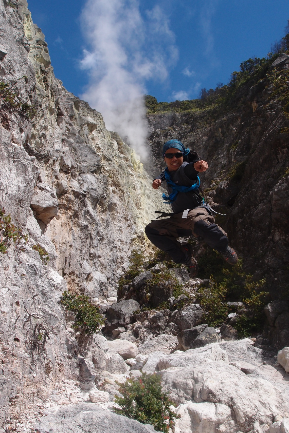 Boyfie's Signature Jump on The Boulder's entrance! See the smoke on the background?!