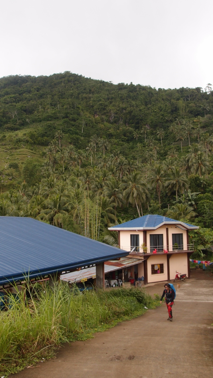 Roof of the gym and the house with the store where Migo & I eagerly shared a bottle of Mirinda to quench our thirst. Yay! This marks the next part of our trail, following the road to the foot of Mauyog.